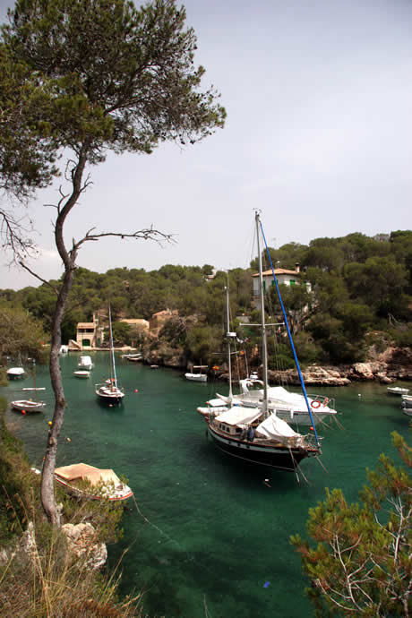Boats in the bay of cala figuera majorca photo